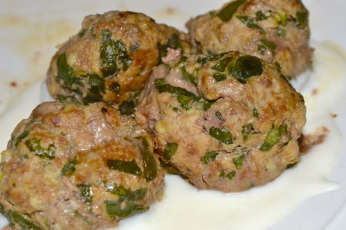 Meatballs finished in a sauce